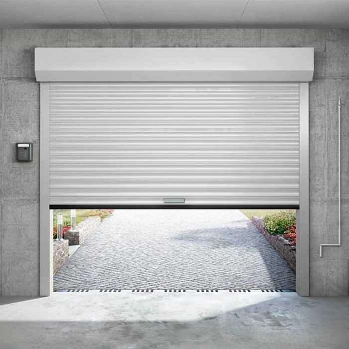Porte de garage enroulable avec coffre intérieur 0